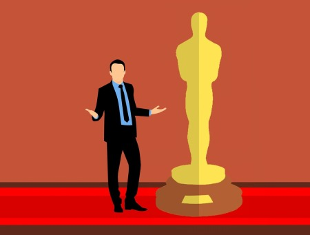 Illustration of a man in formal attire standing next to the Oscar statue, with his arms open in as if asking a question