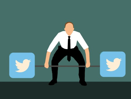 Men in professional clothes holding a dumbbell with twitter logo on both sides
