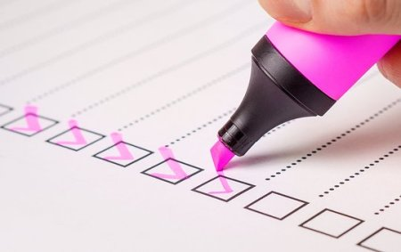 Stock image of a survey being filled out with a pink highlighter.