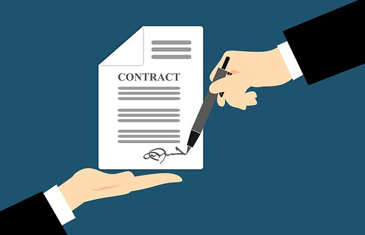 Graphic of a contract being signed.