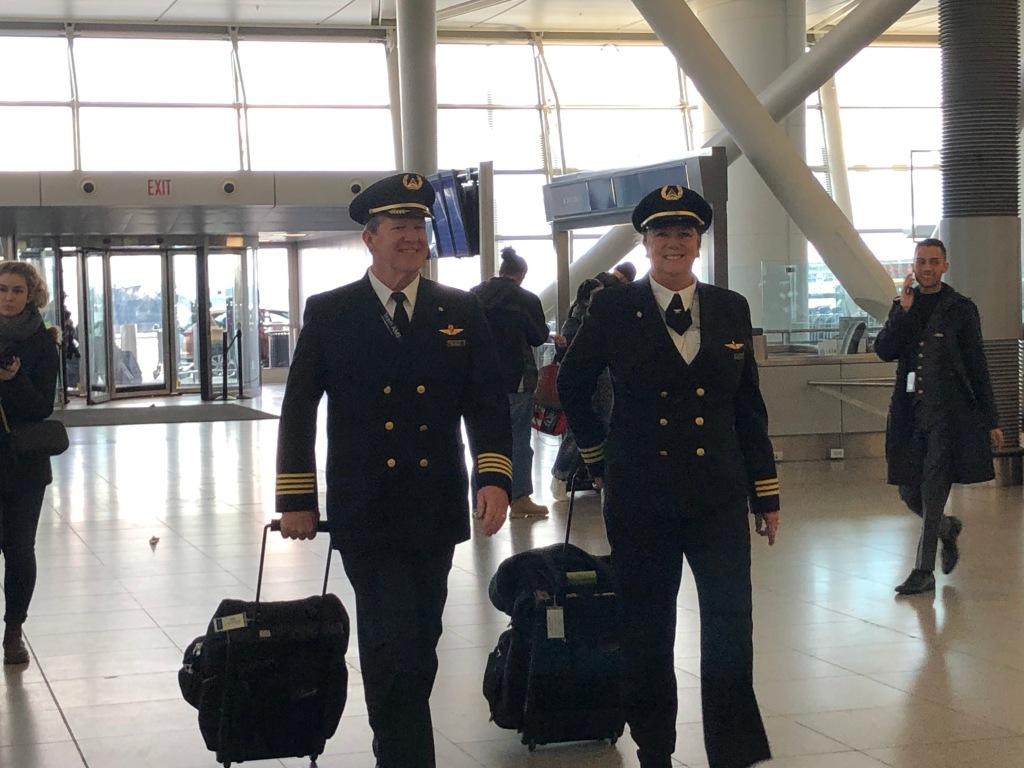 Pilots Joe and Margrit Fahan walk through New York's John F. Kennedy Airport prior to their flight to Paris, France.