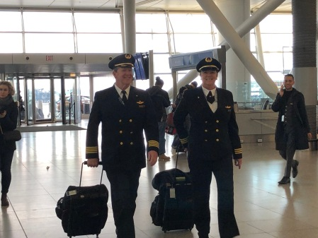 Pilots Joe and Margrit Fahan walk through New York's John F. Kennedy Airport prior to their flight to Paris, France.