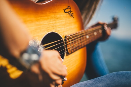 Picture of woman playing a guitar