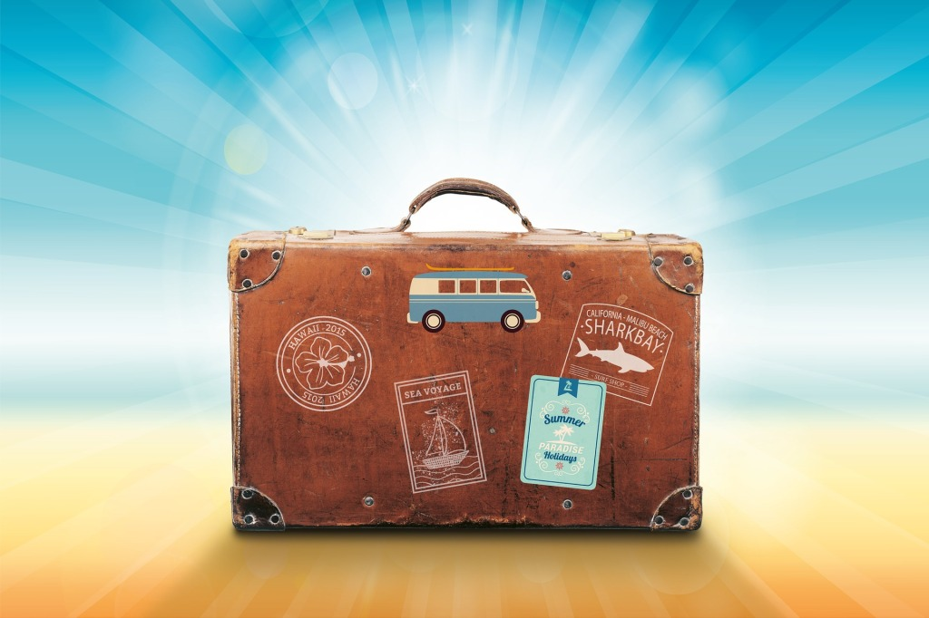 Photo of Luggage with Travel Stickers, Colorful Background